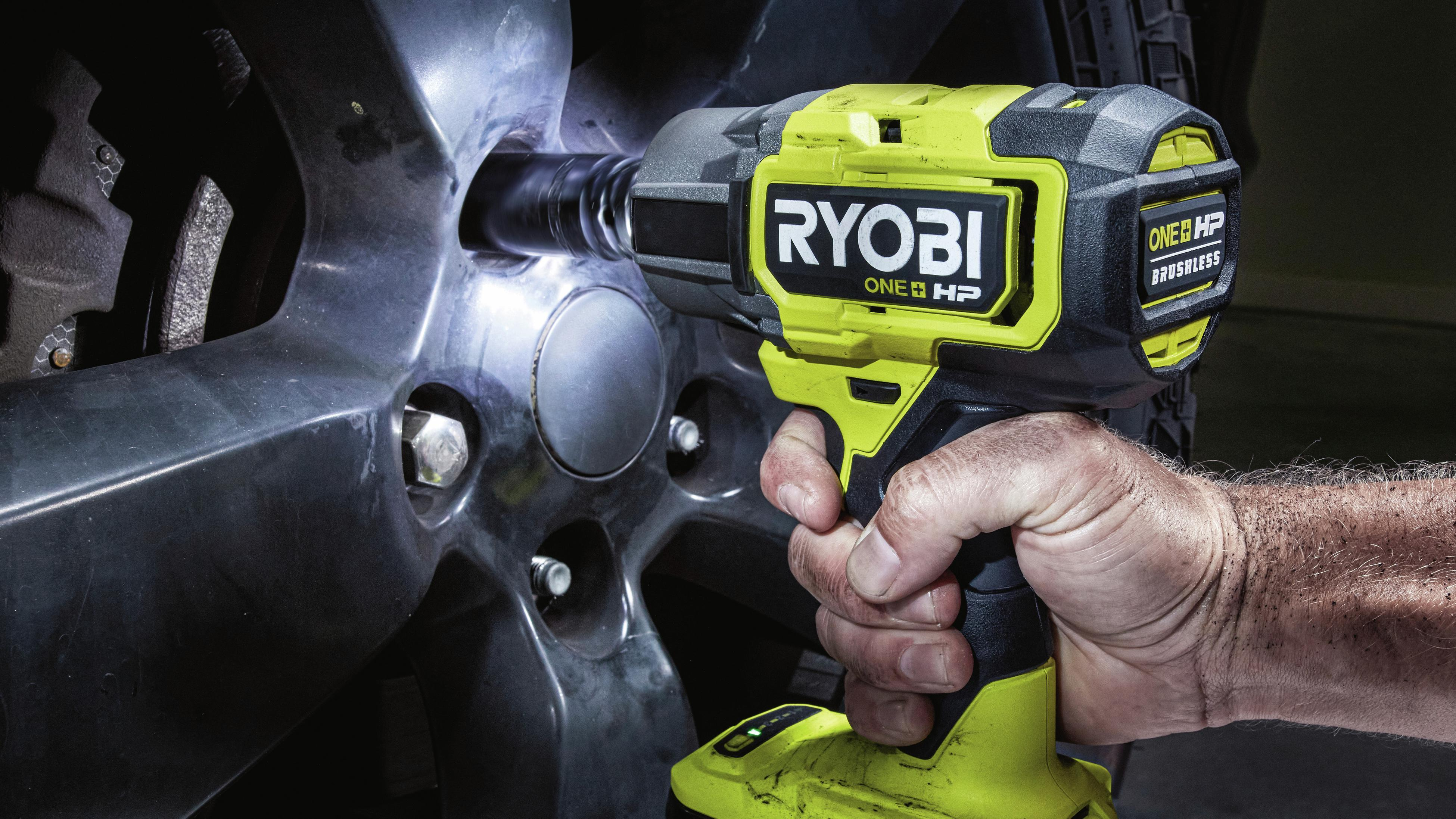 using impact driver to screw bolts on car wheel