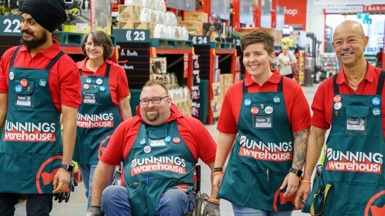 Five Bunnings team members in an aisle.