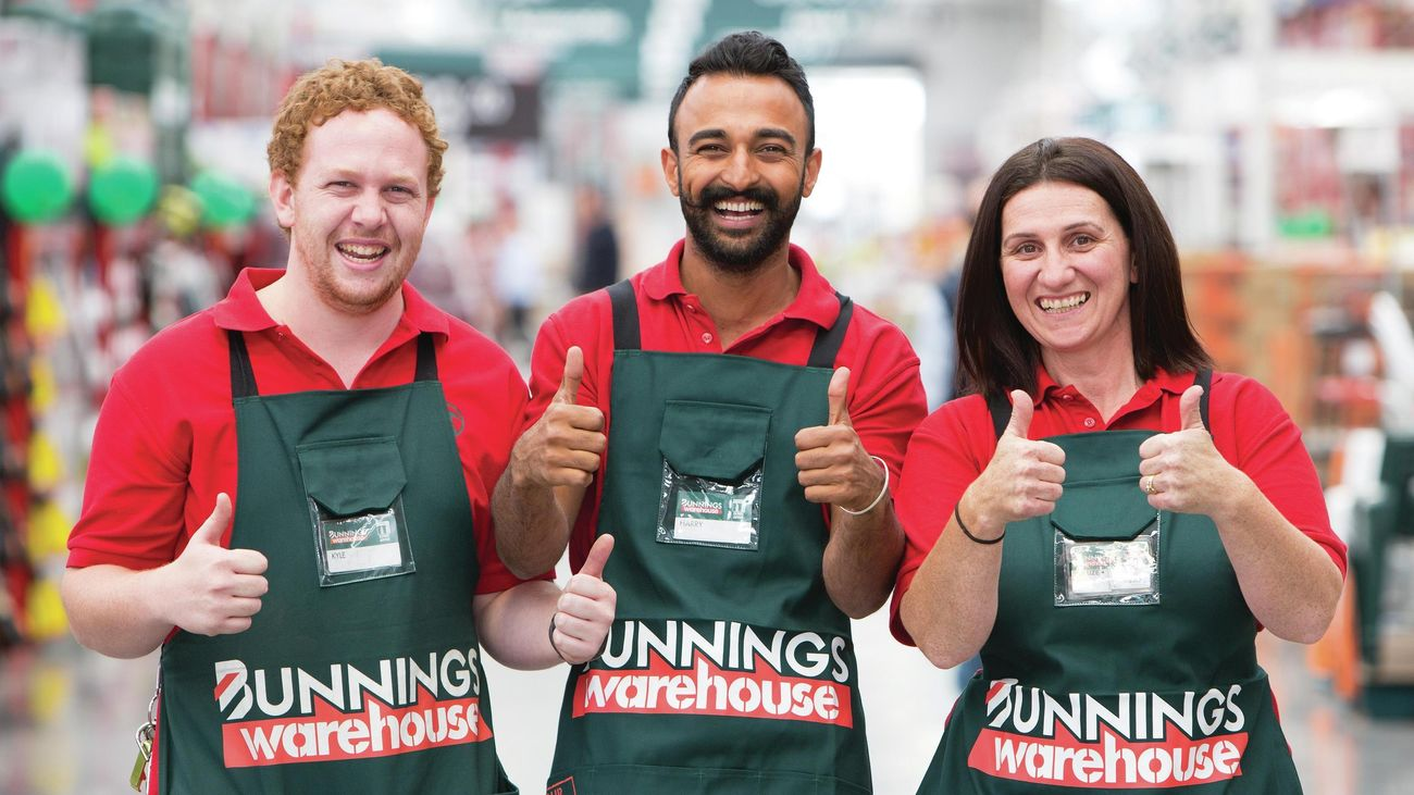 Bunnings team members with thumbs up.