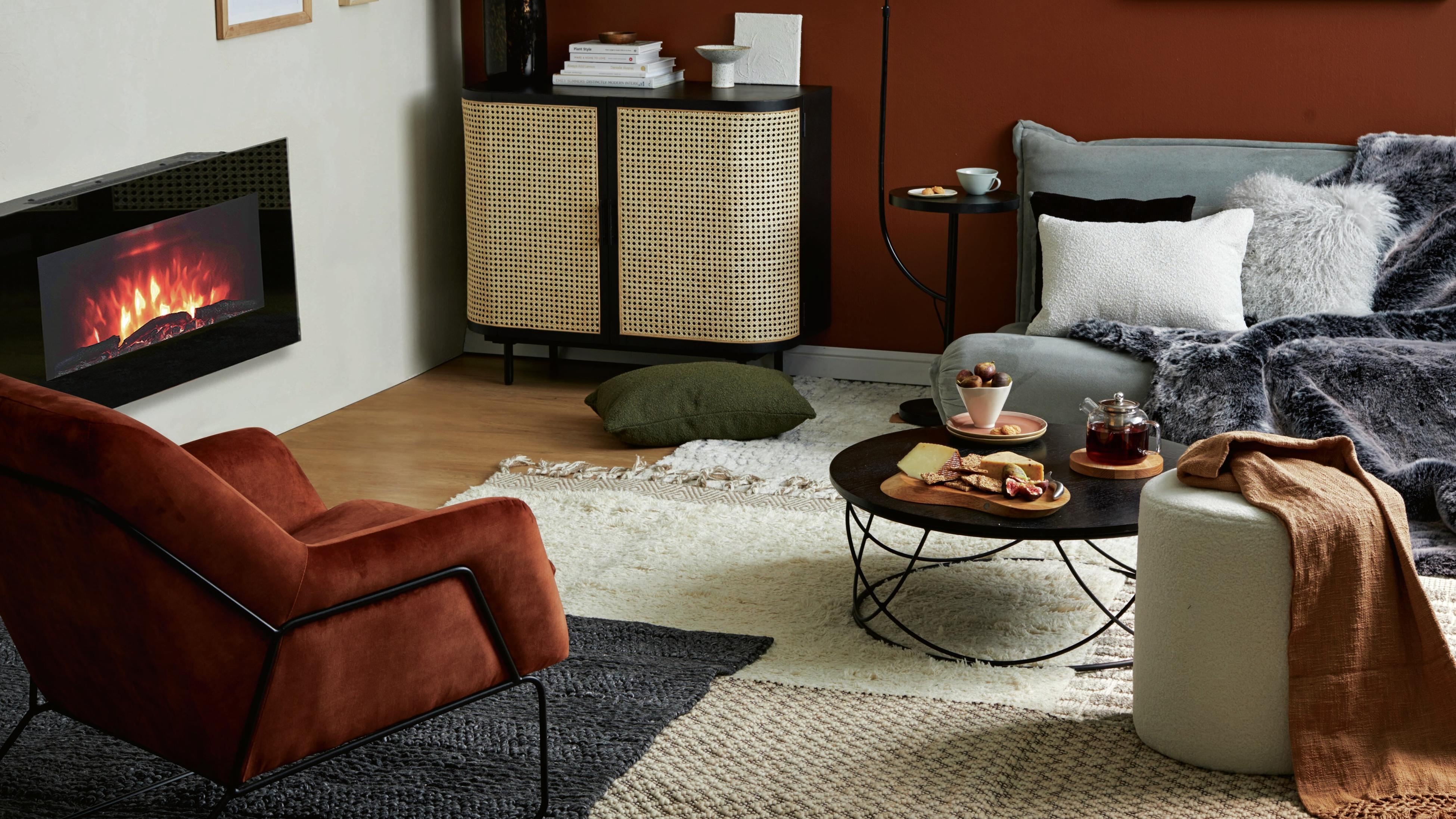Lounge room styled using rich brown hues. Feature wall painted in Tampico Brown by PPG Paints