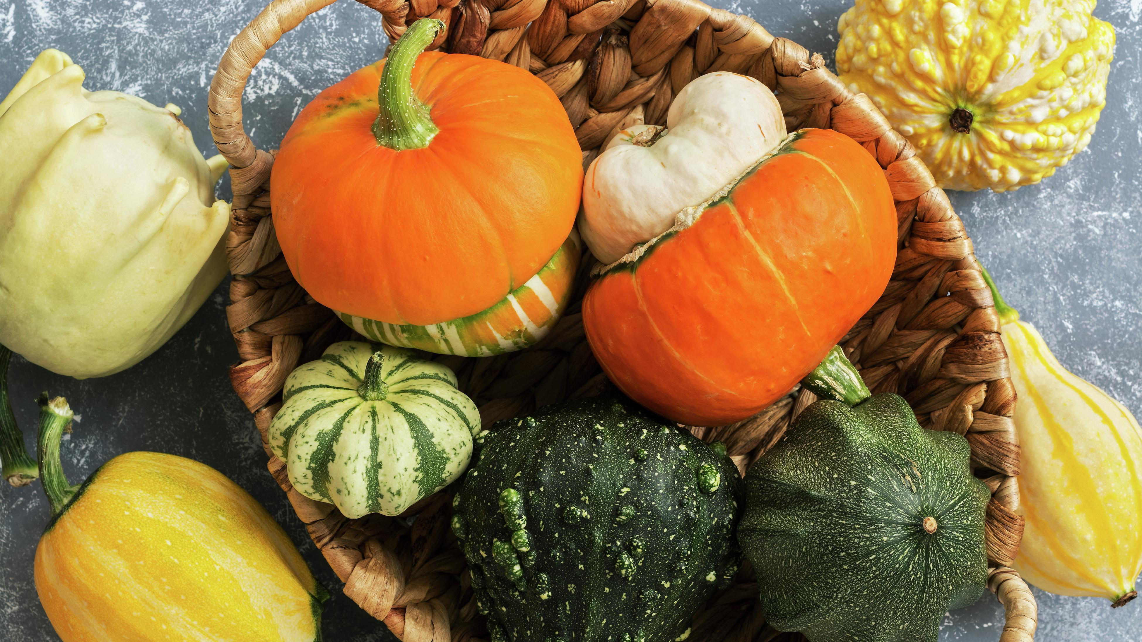 A variety of squash in a basket