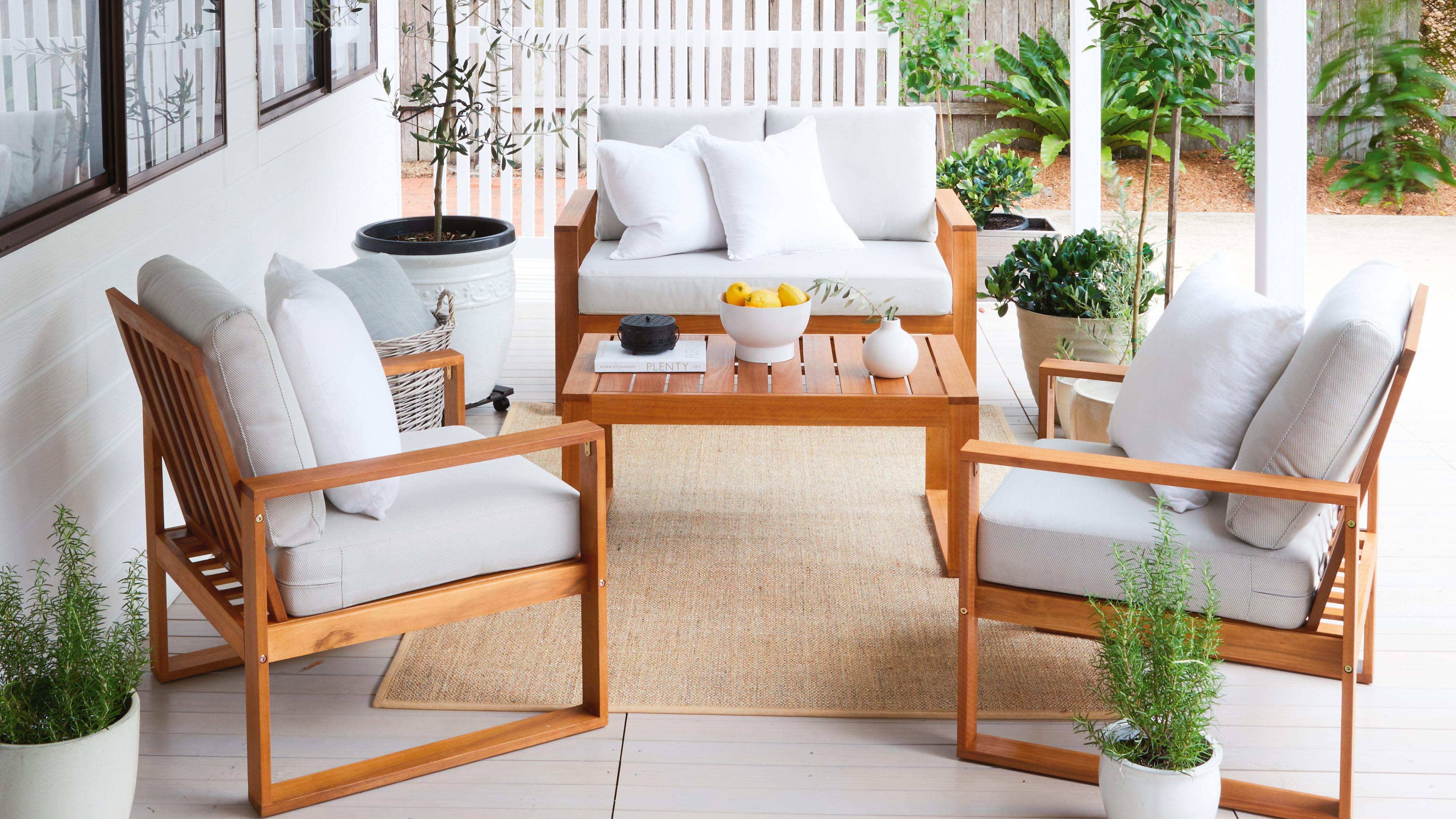 Deck with timber outdoor furniture and potted plants